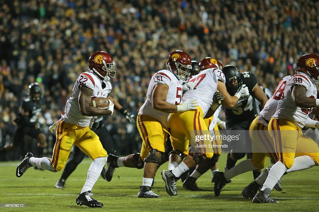 Running back Justin Davis #22 of the USC Trojans runs with the football during the second quarter against the Colorado Buffaloes at Folsom Field on November 13, 2015 in Boulder, Colorado.