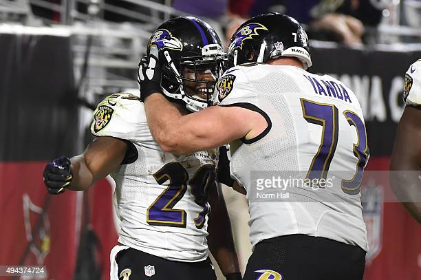 Running back Justin Forsett of the Baltimore Ravens celebrates with offensive guard Marshal Yanda after rushing the football 14 yards to score a...
