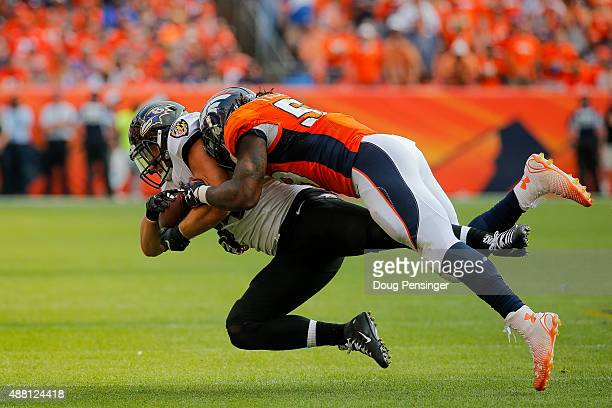 Running back Justin Forsett of the Baltimore Ravens is tackled by outside linebacker Brandon Marshall of the Denver Broncos in the fourth quarter of...