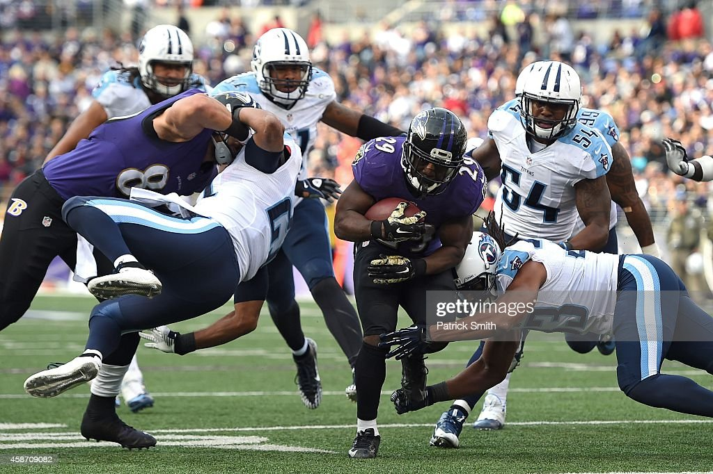 Running back Justin Forsett #29 of the Baltimore Ravens rushes for a third quarter touchdown against the Tennessee Titans at M&T Bank Stadium on November 9, 2014 in Baltimore, Maryland.