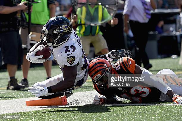 Running back Justin Forsett of the Baltimore Ravens scores a touchdown against George Iloka of the Cincinnati Bengals at MT Bank Stadium on September...