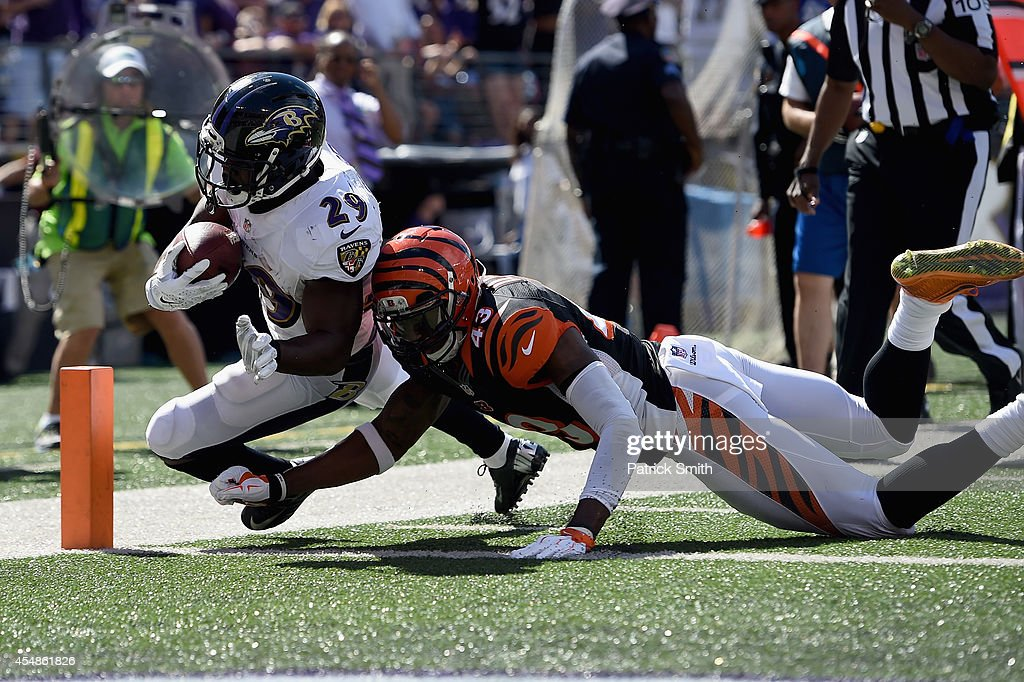 Running back Justin Forsett #29 of the Baltimore Ravens scores a touchdown during an NFL football game against the Cincinnati Bengals at M&T Bank Stadium on September 7, 2014 in Baltimore, Maryland.