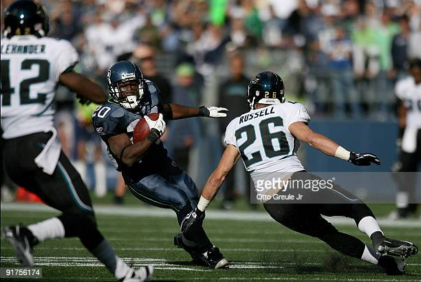 Running back Justin Forsett of the Seattle Seahawks rushes against Brian Russell of the Jacksonville Jaguars on October 11 2009 at Qwest Field in...