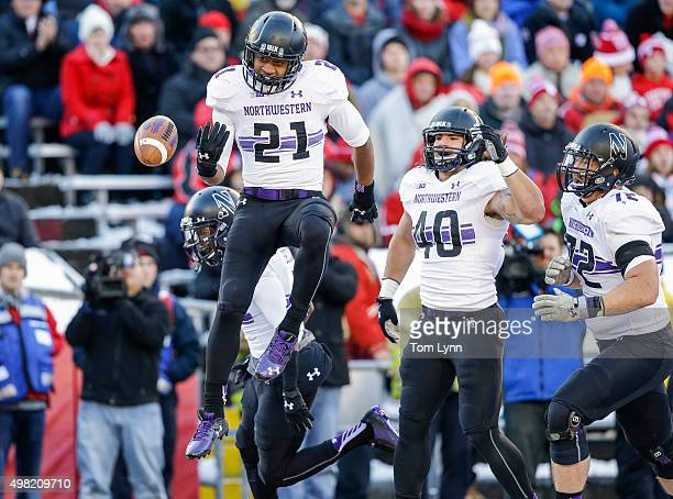 Running back Justin Jackson of Northwestern Wildcats celebrates his touchdown against the Wisconsin Badgers on November 21 2015 at Camp Randall...