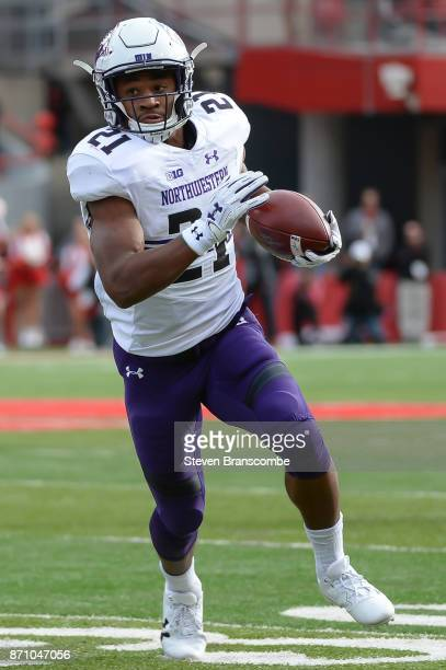 Running back Justin Jackson of the Northwestern Wildcats runs against the Nebraska Cornhuskers at Memorial Stadium on November 4 2017 in Lincoln...