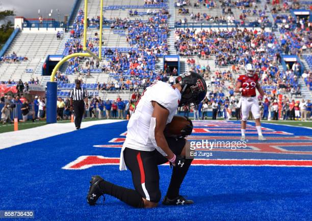Running back Justin Stockton of the Texas Tech Red Raiders celebrates his touchdown run against the Kansas Jayhawks in the first quarter at Memorial...
