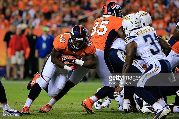 Running back Juwan Thompson of the Denver Broncos rushes for a 2 yard third quarter touchdown against the San Diego Chargers at Sports Authority...