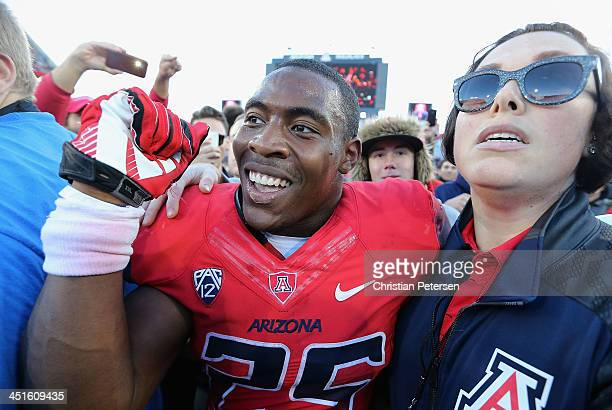 Running back Ka'Deem Carey of the Arizona Wildcats celebrates on the field after defeating the Oregon Ducks 4216 in the college football game at...