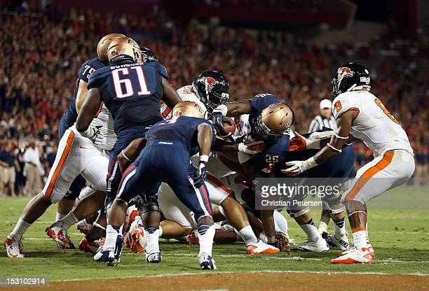 Running back Ka'Deem Carey of the Arizona Wildcats reaches with the football to score on a 1 yard rushing touchdown against the Oregon State Beavers...