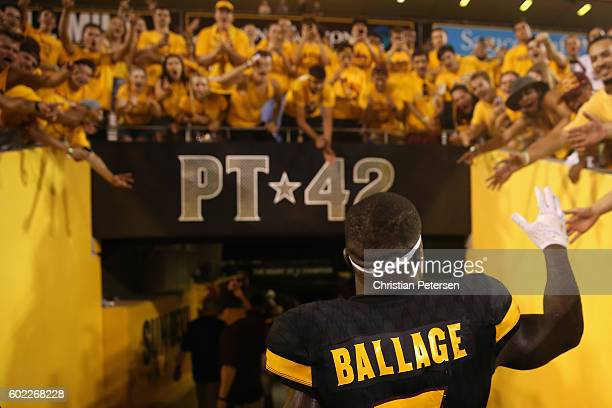 Running back Kalen Ballage of the Arizona State Sun Devils high fives fans as he leaves the field after defeating Texas Tech Red Raiders 6855 in the...