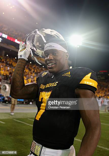 Running back Kalen Ballage of the Arizona State Sun Devils reacts on the field after defeating Texas Tech Red Raiders 6855 in the college football...
