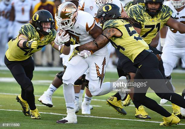 Running back Kalen Ballage of the Arizona State Sun Devils runs through linebacker De'Quan McDowell of the Oregon Ducks for a touchdown during the...