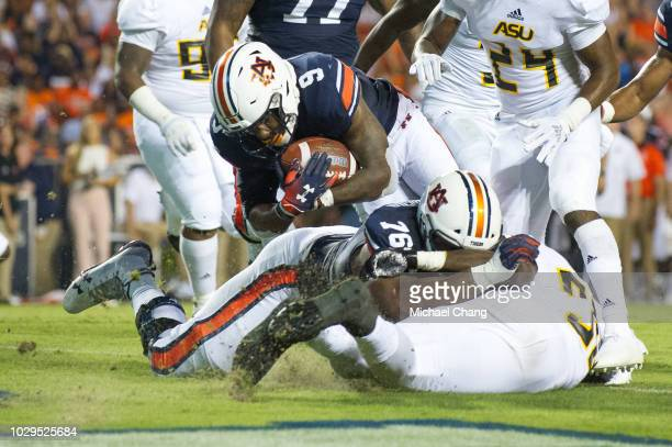 Running back Kam Martin of the Auburn Tigers dives into the endzone for a touchdown during their game against the Alabama State Hornets in the second...