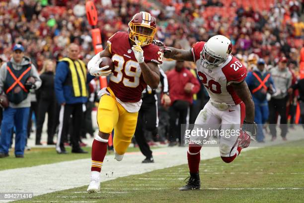Running Back Kapri Bibbs of the Washington Redskins rushes for a touchdown in the second quarter against the Arizona Cardinals at FedEx Field on...