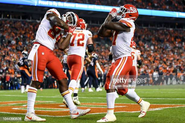 Running back Kareem Hunt and tight end Demetrius Harris celebrate after a fourth quarter Hunt touchdown against the Denver Broncos at Broncos Stadium...