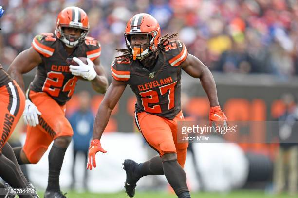 Running back Kareem Hunt blocks for running back Nick Chubb of the Cleveland Browns during the first half against the Buffalo Bills at FirstEnergy...