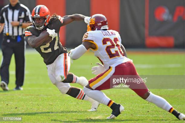 Running back Kareem Hunt of the Cleveland Browns evades strong safety Landon Collins of the Washington Football Team during the fourth quarter at...