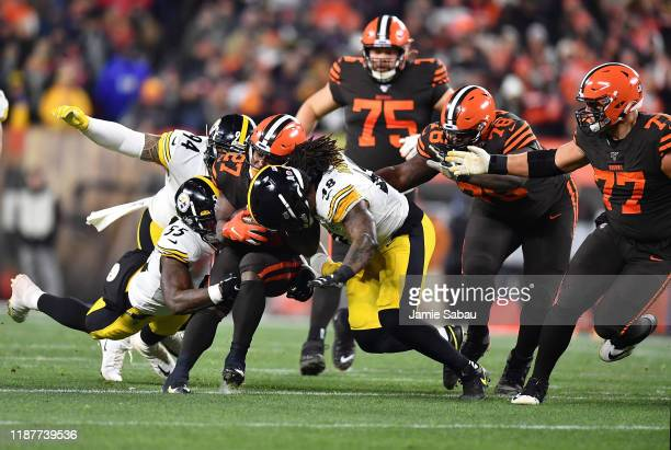 Running back Kareem Hunt of the Cleveland Browns is tackled by the defense of outside linebacker Bud Dupree of the Pittsburgh Steelers during the...
