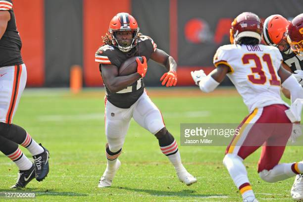 Running back Kareem Hunt of the Cleveland Browns runs for a gain during the first half against the Washington Football Team at FirstEnergy Stadium on...