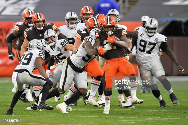 Running back Kareem Hunt of the Cleveland Browns rushes the football past linebacker Nicholas Morrow of the Las Vegas Raiders during the second half...