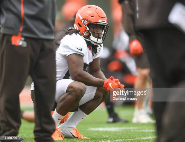 Running back Kareem Hunt of the Cleveland Browns watches a drill during an OTA practice on May 22, 2019 at the Cleveland Browns training facility in...