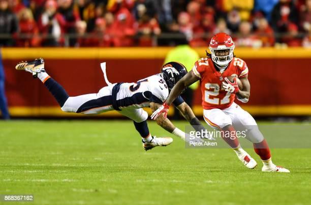 Running back Kareem Hunt of the Kansas City Chiefs avoids the tackle attempt of outside linebacker Shane Ray of the Denver Broncosat Arrowhead...