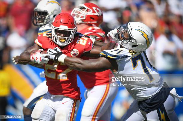 Running back Kareem Hunt of the Kansas City Chiefs carries the ball and is tackled by defensive tackle Damion Square of the Los Angeles Chargers in...