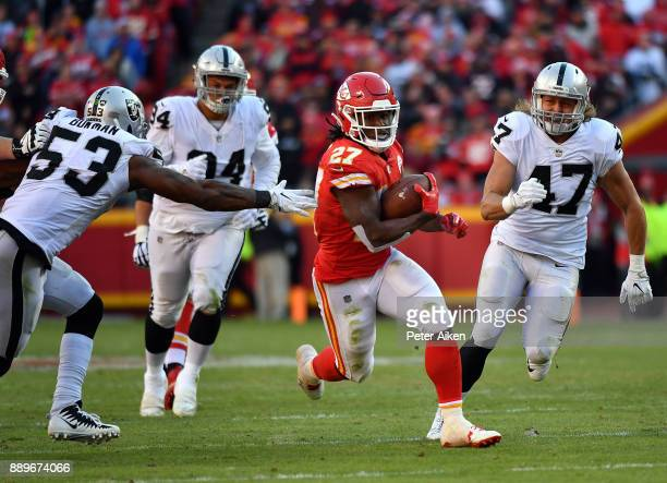 Running back Kareem Hunt of the Kansas City Chiefs carries the ball during the game against the Oakland Raiders at Arrowhead Stadium on December 10...