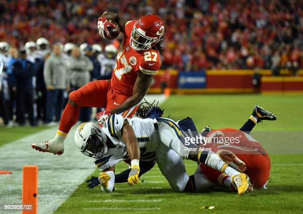 Running back Kareem Hunt of the Kansas City Chiefs carries the ball as free safety Adrian Phillips of the Los Angeles Chargers knocks him outofbounds...