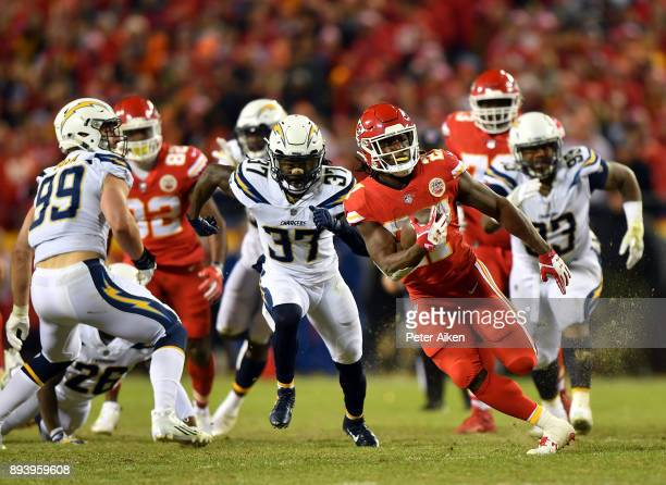 Running back Kareem Hunt of the Kansas City Chiefs carries the ball during the game against the Los Angeles Chargers at Arrowhead Stadium on December...