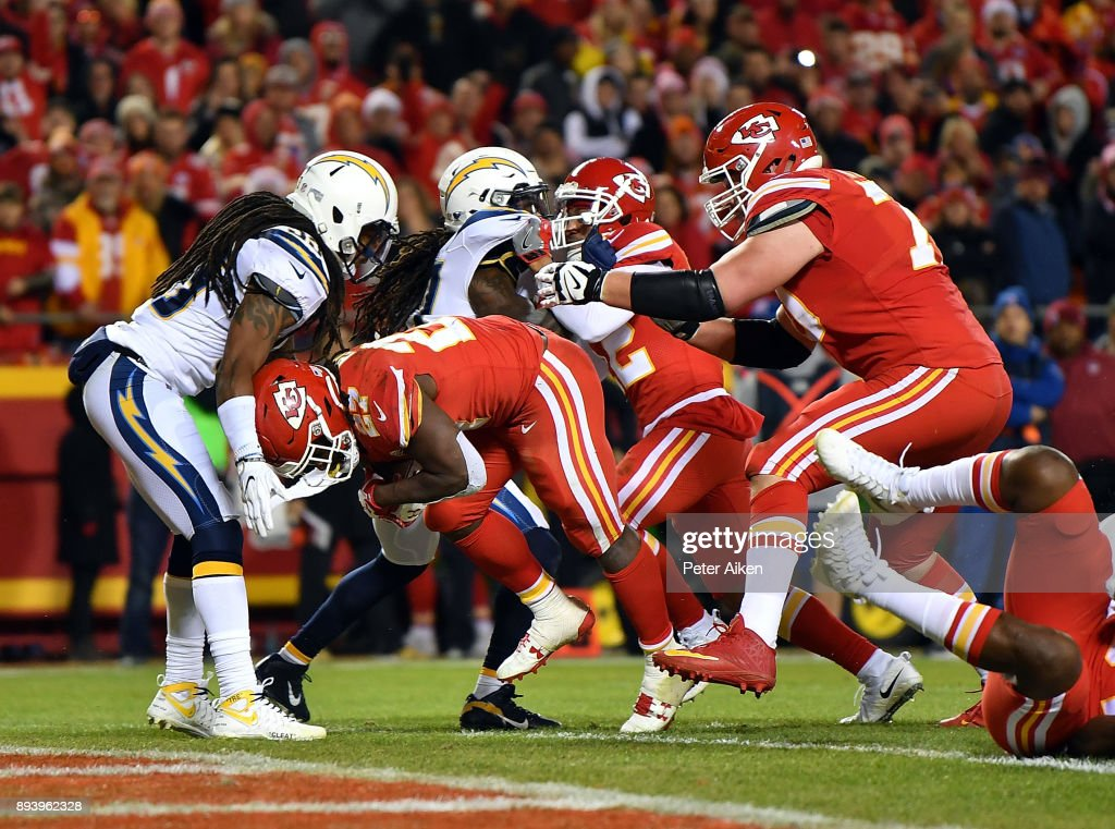 Running back Kareem Hunt #27 of the Kansas City Chiefs carries the ball over the goal line for a touchdown during the game against the Los Angeles Chargers at Arrowhead Stadium on December 16, 2017 in Kansas City, Missouri.
