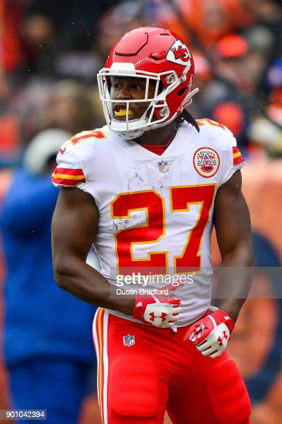 Running back Kareem Hunt of the Kansas City Chiefs celebrates after a first quarter touchdown run against the Denver Broncos at Sports Authority...