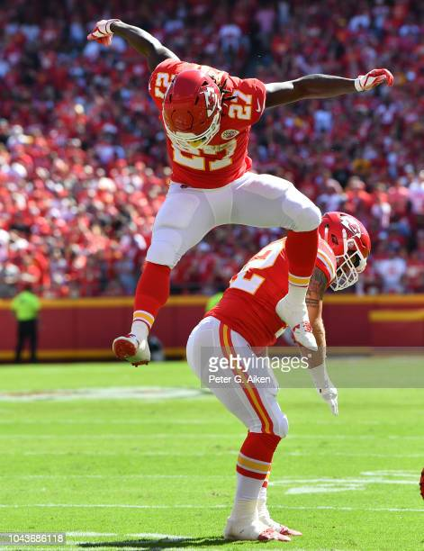 Running back Kareem Hunt of the Kansas City Chiefs celebrates after scoring a touchdown with running back Anthony Sherman during the first half...