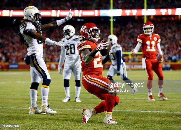 Running back Kareem Hunt of the Kansas City Chiefs celebrates after scoring a touchdown during the game against the Los Angeles Chargers at Arrowhead...