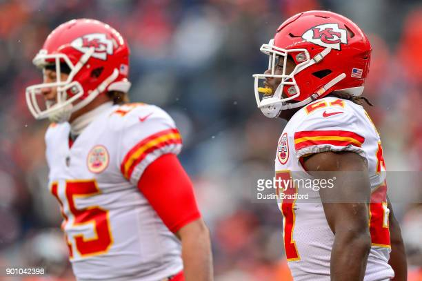 Running back Kareem Hunt of the Kansas City Chiefs celebrates along with Quarterback Patrick Mahomes after a first quarter touchdown run against the...