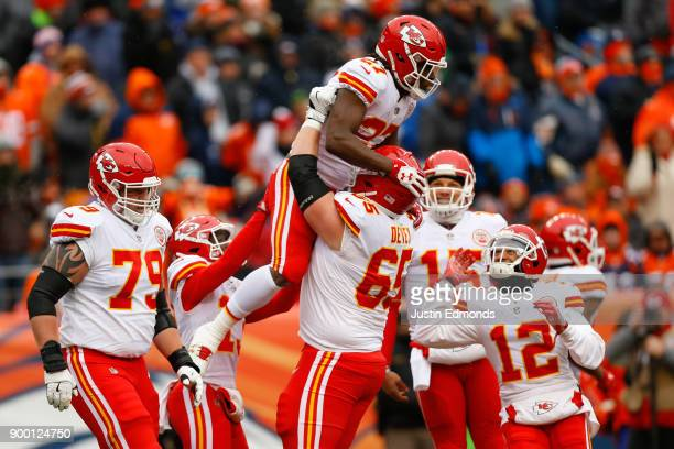 Running back Kareem Hunt of the Kansas City Chiefs celebrates his firstquarter touchdown with offensive tackle Jordan Devey offensive guard Parker...