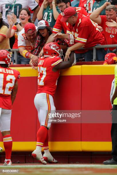 Running back Kareem Hunt of the Kansas City Chiefs celebrates with fans after a 53yard touchdown rush during the third quarter of the game against...