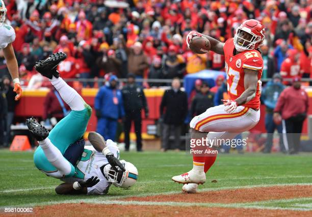 Running back Kareem Hunt of the Kansas City Chiefs crosses the goal line on a one yard touchdown run over outside linebacker Lawrence Timmons of the...
