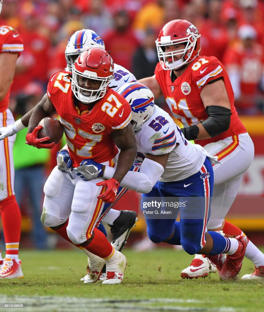 Running back Kareem Hunt #27 of the Kansas City Chiefs gets tackled from behind by linebacker Preston Brown #52 of the Buffalo Bills during the second half at Arrowhead Stadium on November 26, 2017 in Kansas City, Missouri.