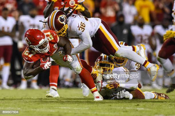Running back Kareem Hunt of the Kansas City Chiefs is tackled by safety DJ Swearinger Keith Marshall and Kendall Fuller of the Washington Redskins...