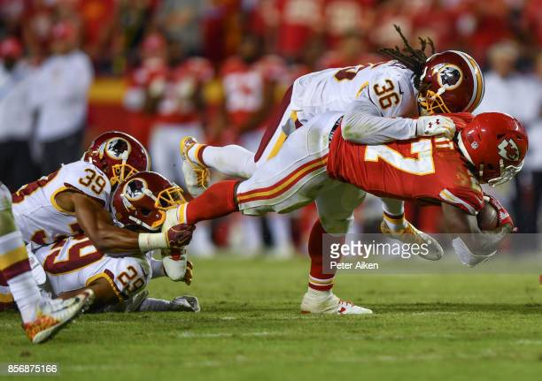 Running back Kareem Hunt of the Kansas City Chiefs is tackled by free safety DJ Swearinger of the Washington Redskins during the third quarter of the...