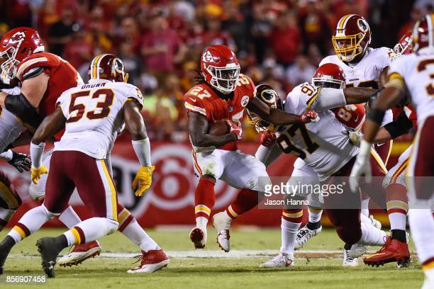 Running back Kareem Hunt of the Kansas City Chiefs makes a jump cut to try and avoid the tackle attempt of inside linebacker Zach Brown of the...