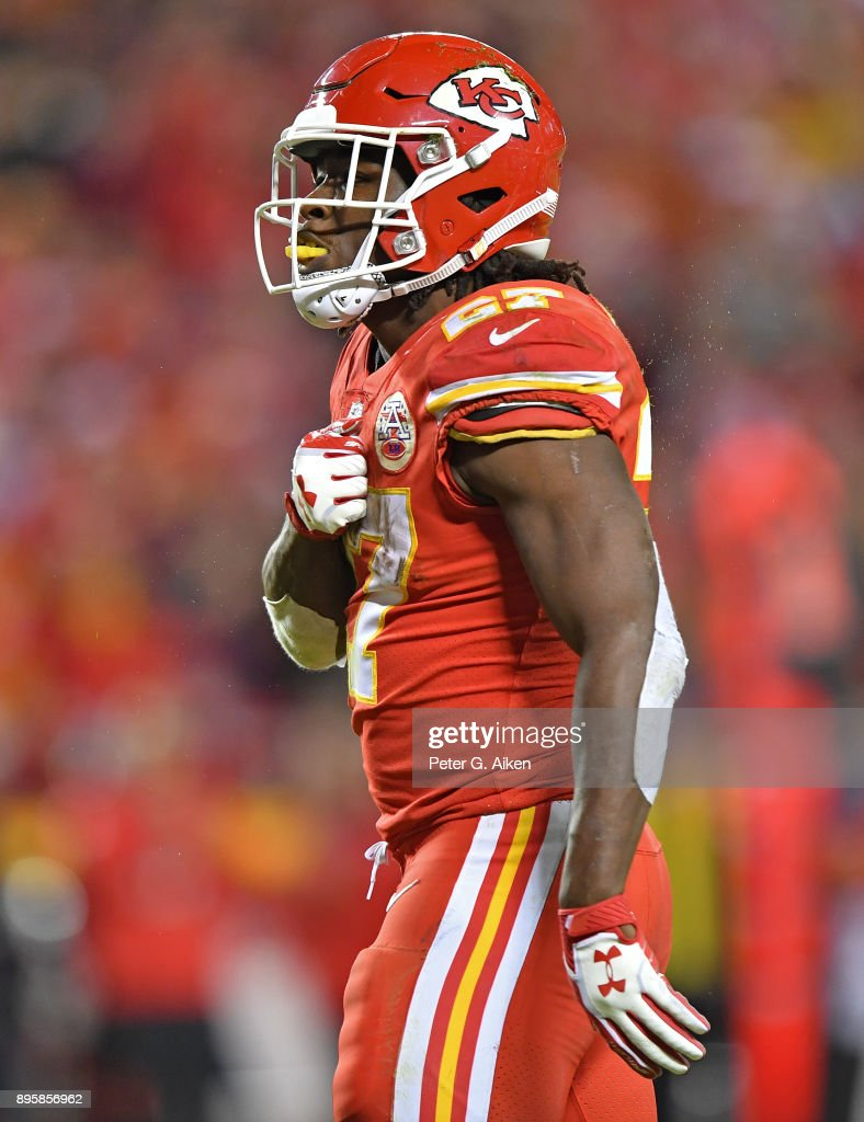 Running back Kareem Hunt #27 of the Kansas City Chiefs reacts after picking up a first down against the Los Angeles Chargers during the second half at Arrowhead Stadium on December 16, 2017 in Kansas City, Missouri.