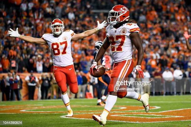 Running back Kareem Hunt of the Kansas City Chiefs runs into the end zone with a fourth quarter touchdown as tight end Travis Kelce starts to...