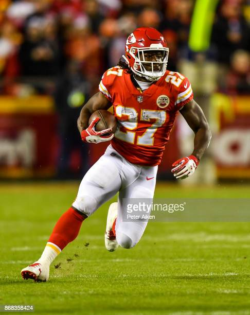 Running back Kareem Hunt of the Kansas City Chiefs runs the ball against the Denver Broncos during the first half of the game at Arrowhead Stadium on...