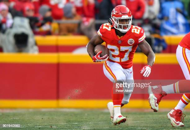 Running back Kareem Hunt of the Kansas City Chiefs runs through a huge hole during the first quarter of the AFC Wild Card playoff game against the...