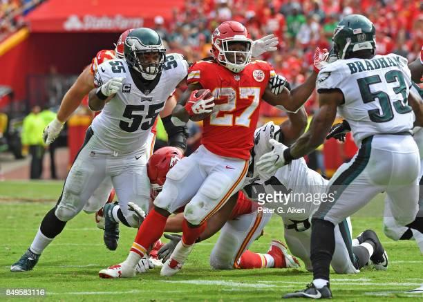 Running back Kareem Hunt of the Kansas City Chiefs runs up field between defenders Brandon Graham and Nigel Bradham of the Philadelphia Eagles during...