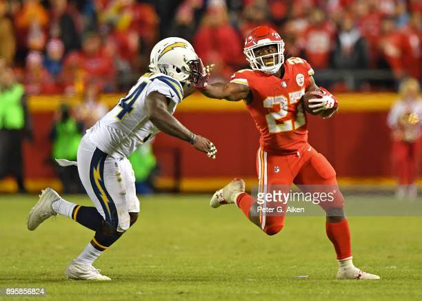 Running back Kareem Hunt of the Kansas City Chiefs runs up field against outside linebacker Melvin Ingram of the Los Angeles Chargers during the...