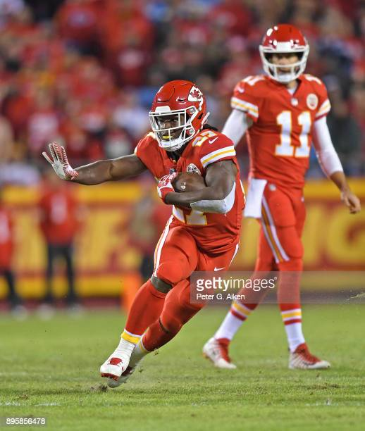 Running back Kareem Hunt of the Kansas City Chiefs runs up field against the Los Angeles Chargers during the first half at Arrowhead Stadium on...