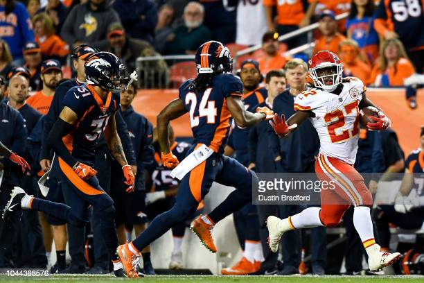 Running back Kareem Hunt of the Kansas City Chiefs rushes for 48 yards against the Denver Broncos in the second quarter of a game at Broncos Stadium...